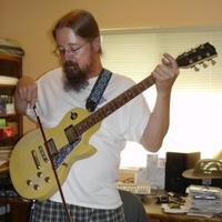 Lonny Balderston bowing his guitar.